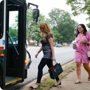 Two Women Getting on the Bus
