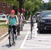 Cyclists riding in protected bike lane