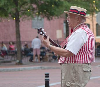 Man playing banjo on Main Street